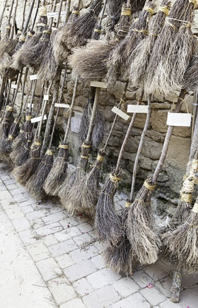 requisite: Parking witches brooms, detail of an old broom witchcraft, decoration and fear Stock Photo