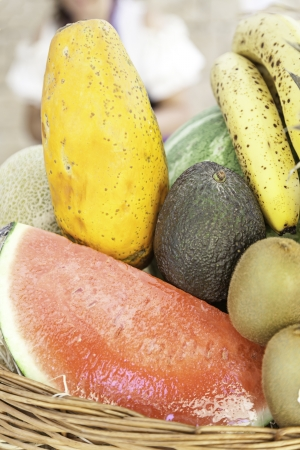 Different tropical fruits, detail of a tray with different fresh fruits, healthy lifestyle food, sweet photo