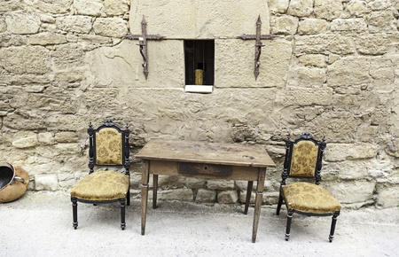 Table and chairs of the Inquisition, detail of a scene from the old Spanish Inquisition, religicion and furniture photo