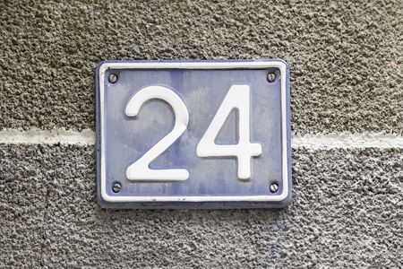 Number twenty, detail of a plaque in the town with the number twenty four, signal and symbol, figure photo