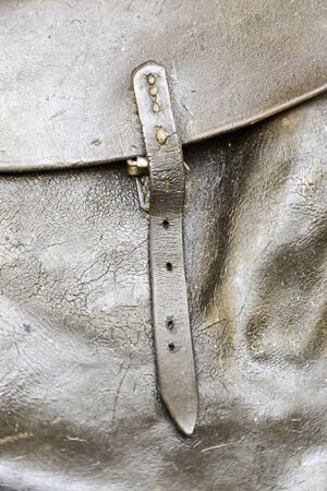 Leather buckle bag, detail of a cowhide bag, old and dirty photo