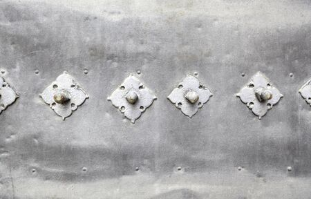 Metallic background with texture, detail of an old door painted metal, decoration and outdoor protection, steel Stock Photo - 21560003