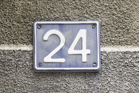 Number twenty, detail of a plaque in the town with the number twenty four, signal and symbol, figure