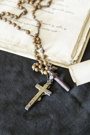 Antique Book with Cross, detail of an old book and a crucifix religious inquisition scene Stock Photo