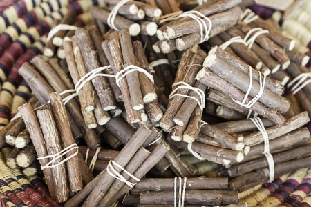 Licorice sticks, detail of fresh licorice sticks, craft sale in a market Stock Photo - 21560396