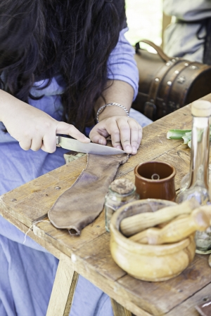 Woman working leather, detail of hands working with leather, old craftsmanship