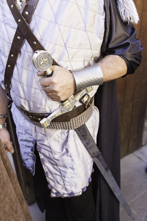 Medieval warrior with sword, detail of a medieval warrior ready for war