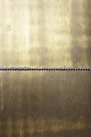 Metal rusty gold, detail of a wall of metal and welded gold, copper and bronze Stock Photo - 21941148