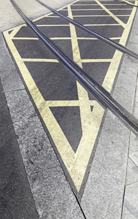 Routes of tram in the city, detail of an urban transport circulation signal, asphalt and city transport photo