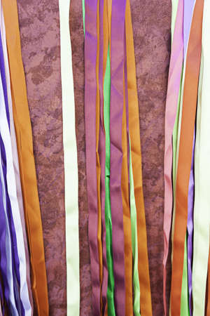 Satin strips colors, detail of a colorful fabrics for furnishings, bright and soft tissue photo