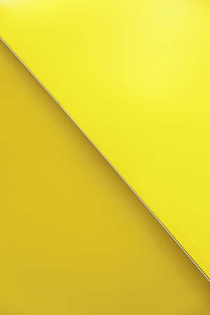 Background of yellow and orange, detail of a wall decorated with colors, background and texture, color photo