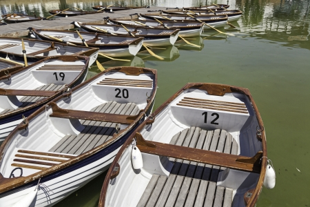 Recreational boats, detail of rowing boats for a stroll along the water, sport and fun, nautical photo