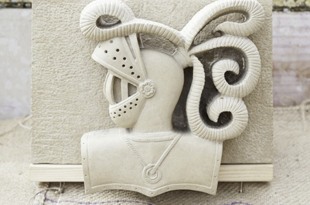 Medieval stone carving, detail of a medieval knights head, traditional arts and crafts photo