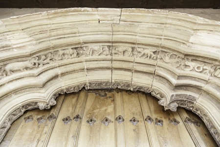 Old porch of a church, detail of a gothic church decoration in ne Spain, ancient art photo