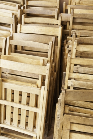 Old wooden chairs, detail of a closed wooden chairs, seating, rest and relaxation photo