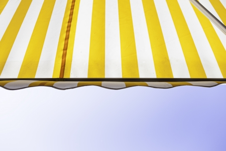 Awning with sky detail of a fabric to protect from the sun, protection and decoration, colors Stock Photo