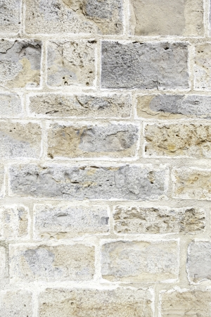 Old stone wall texture, detail of a stone facade on an old monument, history and architecture, resistance photo