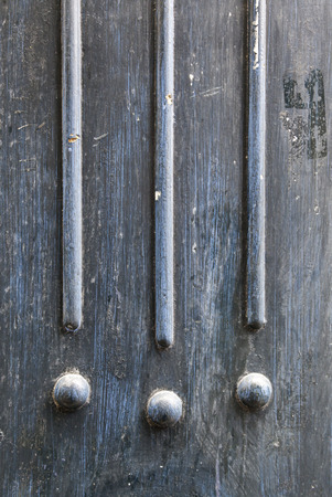 Painted and decorated metal wall, detail of an old door of abandoned metal, detail and exploration Stock Photo - 22653404