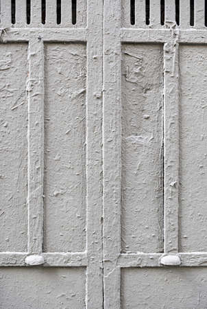Old painted metal door, detail of an old wall abandoned metal, textured Stock Photo - 22653455
