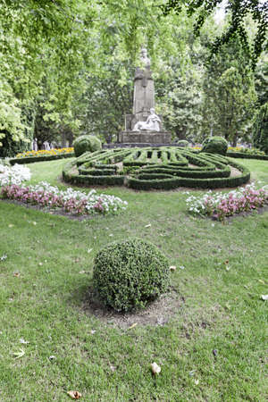 Garden with statue, detail of a classic botanical garden with antique statues, nature photo