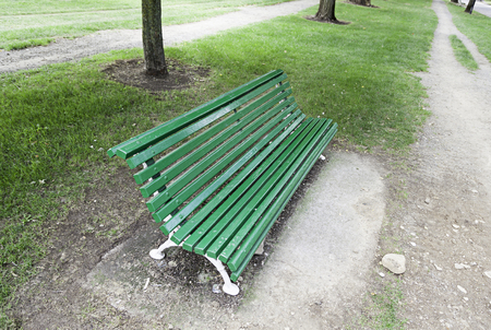 Wooden bench seating, detail of a seat in the woods, relaxing on nature photo