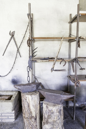 Anvils in an old blacksmith, detail of tools for shaping metal, traditional job photo