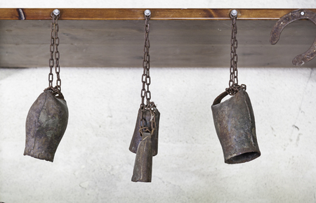 tarnished: Old rusty bells, tools for farm animals, old abandoned