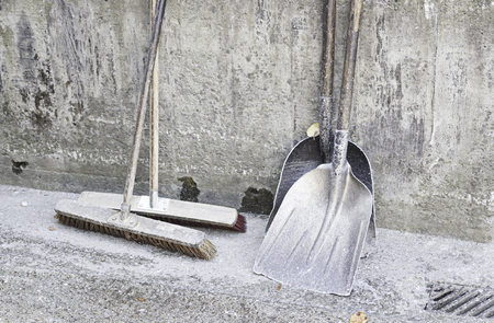 Broom and dustpan, cleaning tools detail, order and care photo