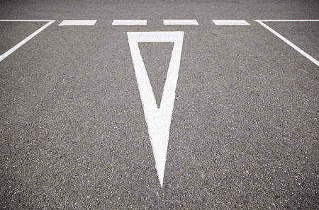 Give Way sign on the asphalt, detail of an information signal in Carratera, safety and respect