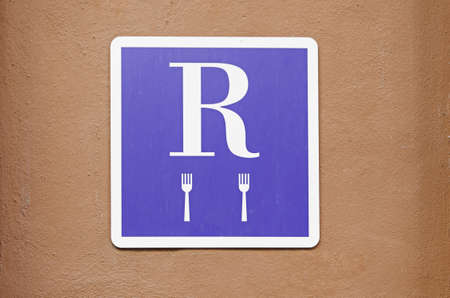 Plate with restaurant sign, detail of an information signal of a place for lunch or dinner photo