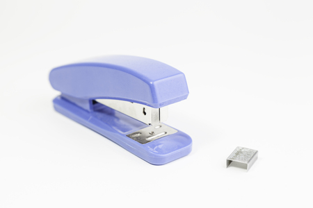 Plastic stapler with staples, detail of a tool for school, school supplies Stock Photo - 23429303