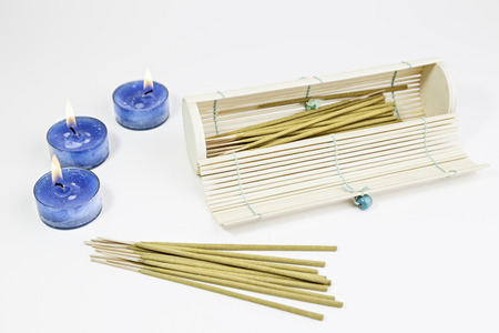 Candles with oriental incense, detail of spa and relaxation, ancient oriental art Stock Photo