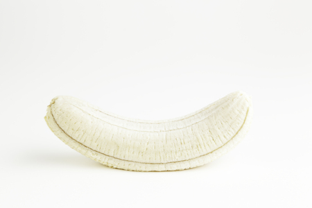 Peeled banana, detail of a fresh tropical fruit, healthy food, dessert and diet photo
