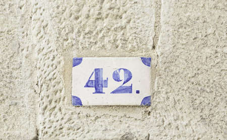 naught: Number forty-two, detail of a number of information on a wall of a house number