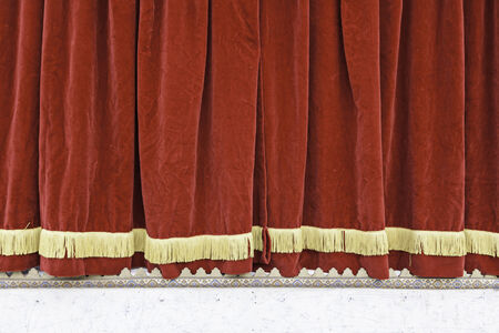 Red theater curtain, detail of a closed theater, red velvet, decoration and art Stock Photo
