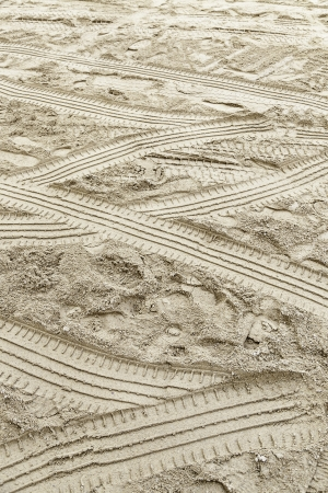 Wheel tracks in the sand, detail of car brands in the sand, sign and mark, indication photo