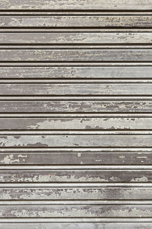 Old wooden fence, detail of a wall covered with wood protection and decoration, dirty and abandoned