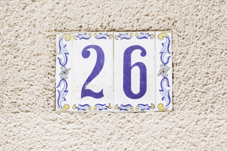 Number twenty in the city, a number of detailed information on a wall, text and figure