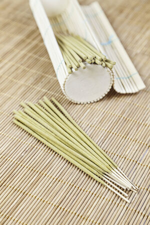 Aromatic incense on bamboo detail in an oriental spa aromatherapy, relaxation and health photo