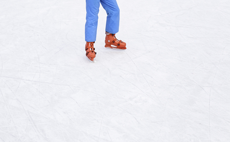 Skating on the ice, skating young person in an ice rink Stock Photo