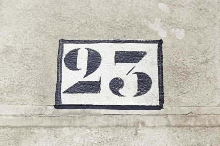 Number twenty on a wall, detail of figures on the wall of a house number information