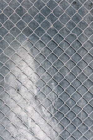 Metal grid on the wall, detail of a person protected by a metal wall grilles, protection and security photo