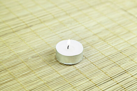 Candle wax on bamboo detail of a white candle in a spa relaxation, health and relax, zen culture Stock Photo - 25466424