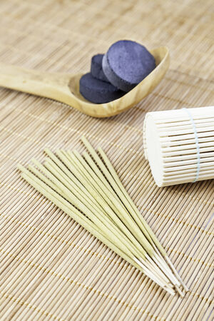 Aromatic incense with charcoal and bamboo detail aromatherapy spa treatment relaxation photo