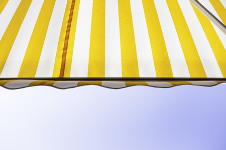Awning with sky detail of a fabric to protect from the sun, protection and decoration, colors 스톡 콘텐츠
