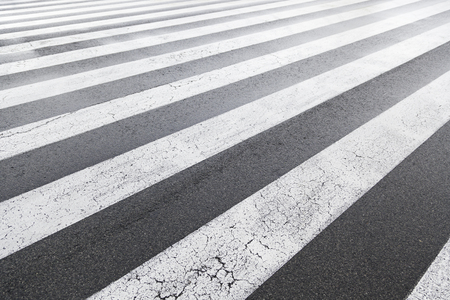 Zebra crossing painted on the asphalt, detail of a signal circulation, traffic information for pedestrians and drivers, security photo