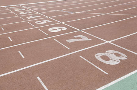 Detail of an athletics track, detail of a running track, outdoor sports, aerobic sports, output numbers photo