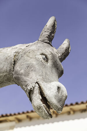Donkey shaped statue, detail of a figure of a donkey, decoration and fun photo
