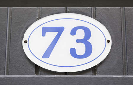 number plate: Plate with number seventy-three, detail infromacion with plate numbers, figures