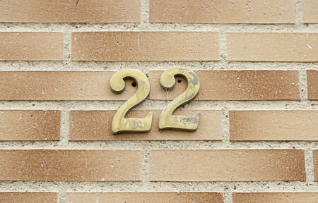 Number twenty two on a wall, detail of a wall with information about numbers, even numbers photo
